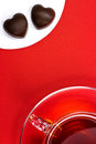 Tea cup and chocolate hearts Royalty Free Stock Images