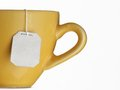 Tea cup hot bag on yellow Stock Images