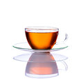 Tea cup isolated on white background one is in glass with brown fruit Royalty Free Stock Photography