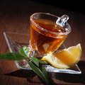 Tea cup and lemon on a wooden table Stock Images