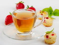 Tea cup and muffins Royalty Free Stock Images
