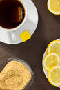 Tea cup slices of lemon and brown sugar aerial view Royalty Free Stock Photo