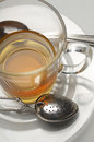 Tea Cup With Strainer In Saucer Stock Images
