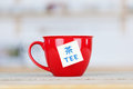 Tea cup with tag on table closeup of in kitchen Royalty Free Stock Image