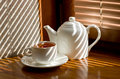 Tea cup with teapot Royalty Free Stock Photo