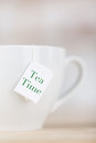Tea cup wit tag of tea time on it cropped image Royalty Free Stock Photos