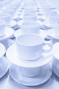Tea cups row of white prepared for the lunch monochromatic Stock Photos