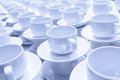 Tea cups row of white prepared for the lunch monochromatic Stock Images