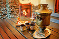 Tea drinking at a fireplace russian with samovar Stock Photo
