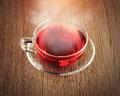 Tea in a glass cup on the wooden table retro style theme Stock Photo