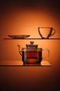 Tea glassy tapot with and empty teacup Royalty Free Stock Photos
