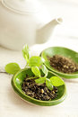 Tea green leaves and teapot Royalty Free Stock Images