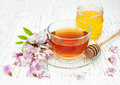 Tea and honey with acacia blossoms Royalty Free Stock Photo