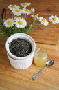 Tea with honey and camomile green little jar of spoon fresh Stock Photography