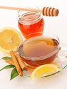 Tea with honey lemon and cinnamon in glass cup Stock Photo