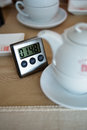 Tea infusion timer near cup Stock Photo