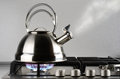 Tea kettle boiling water gas stove Royalty Free Stock Photography