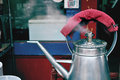 Tea kettle boiling water old with Royalty Free Stock Photo