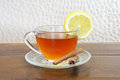 Tea with lemon cup of and cinnamon sticks Royalty Free Stock Image