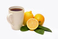 Tea with lemon and some fruit Stock Images