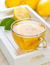 Tea with lemon on the tray on a white wooden background Stock Image