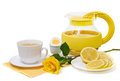 Tea with lemon and yellow roses Royalty Free Stock Image
