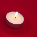 Tea Light on Red Background Royalty Free Stock Image