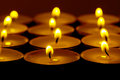 Tea lights candles with fire Royalty Free Stock Photo