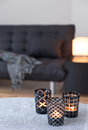 Tea-lights decorating living room with gray sofa Royalty Free Stock Image