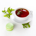 Tea and macaroon cup of black with some mint pistachio Royalty Free Stock Image