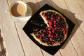 Tea with milk and a berry tart Royalty Free Stock Photo