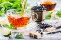 Tea. Mint Tea. Herbal tea. Mint leaf. Mint leaves. Tea in a glass cup, mint leaves, dried tea, sliced lime. herbs tea and mint lea Royalty Free Stock Photo
