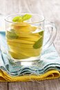 Tea with mint and whole lemon in a transparent cup natural medicine concept Stock Image