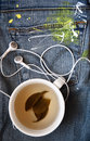 Tea and music cup of green earphones Royalty Free Stock Images