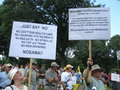 Tea Party Protesters Raise Signs Royalty Free Stock Photo