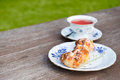 Tea and pastry in garden time to relax Royalty Free Stock Photos
