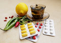 Tea peppers lemon natural remedies vs pills hot for colds and handkerchiefs on table and remedy Royalty Free Stock Image