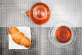 Tea photo of a cup of teapot and croissant the top view Royalty Free Stock Photos