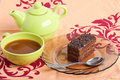 Tea and piece of chocolate cake Royalty Free Stock Photography