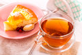 Tea and piece pie cup of of peach Stock Photography