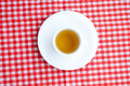 Tea on plaid fabric Stock Image
