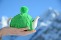 Tea pot knotted cap hand against alpine scenery Royalty Free Stock Images
