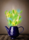Tea pot with leaves and colorful abstract lights Royalty Free Stock Photo