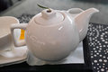 Tea pot white porcelain near the cup Stock Photo