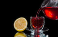 Tea is poured into a glass cup red and lemon close Stock Image