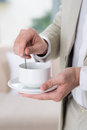 Tea preparing vertical shot of human hands on the foreground Royalty Free Stock Photos
