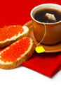 Tea and sandwiches with red caviar Stock Photography