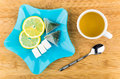 Tea, slices of lemon, lumpy sugar in blue plate Royalty Free Stock Photo