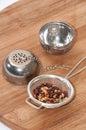 Tea strainer with dog rose tea Royalty Free Stock Photos