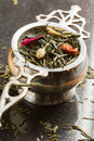 Tea strainer with jasmine and rose green tea Stock Images